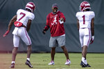 FILE - In this Aug. 12, 2021, file photo, Alabama wide receivers coach Holmon Wiggins works with wide receivers Ja'Corey Brooks (7) and Jameson Williams (1) during NCAA college football practice in Tuscaloosa, Ala. The top-ranked Crimson Tide, which could be called Wide Receiver U. lately, brought in four highly rated recruits and landed Ohio State transfer Jameson Williams. (AP Photo/Vasha Hunt, File)