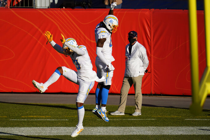 Los Angeles Chargers wide receiver Keenan Allen (13) celebrates his touchdown with wide receiver Mike Williams (81) during the first half of an NFL football game against the Denver Broncos, Sunday, Nov. 1, 2020, in Denver. (AP Photo/Jack Dempsey)