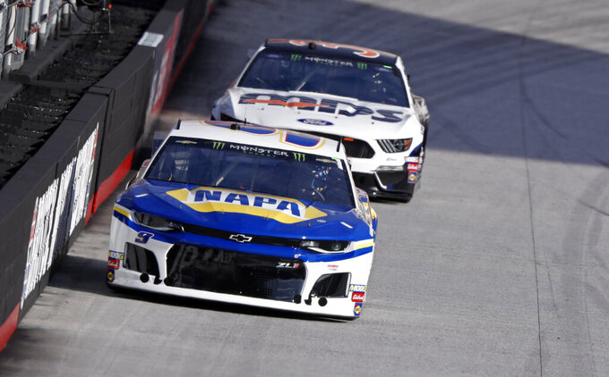 Driver Chase Elliott (9) leads David Ragan (38) during practice for a NASCAR Cup Series auto race, Saturday, April 6, 2019, in Bristol, Tenn. (AP Photo/Wade Payne)