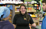 In this Feb. 22 photo, LeAnna Nieratko, Whole Foods Co-Op general manager, center, talks with grocery assistant Gretchen Oat, left, and shift lead cashier Jonny DiPrinzio, at the Erie, Pa., store. When female friends, colleagues and acquaintances continued to move to cities like Pittsburgh, Denver and Nashville to develop their careers and start families, these women chose Erie for their futures. (Greg Wohlford/Erie Times-News via AP)