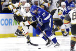 Tampa Bay Lightning left wing Alex Killorn (17) breaks out ahead of Vegas Golden Knights defenseman Brayden McNabb (3) during the second period of an NHL hockey game Tuesday, Feb. 4, 2020, in Tampa, Fla. (AP Photo/Chris O'Meara)