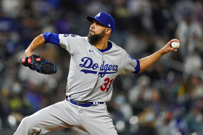 Los Angeles Dodgers relief pitcher David Price works against the Colorado Rockies in the seventh inning of a baseball game Friday, April 2, 2021, in Denver. (AP Photo/David Zalubowski)