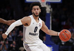 Marquette guard Markus Howard drives against St. John's during the first half of an NCAA college basketball game in the Big East men's tournament, Thursday, March 14, 2019, in New York. (AP Photo/Julio Cortez)