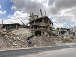 Buildings damaged by Syrian government forces following clashes with rebel fighters are seen in the southern city of Daraa, Syria, Sunday, Sept 12, 2021. A Russian-negotiated deal went into effect last week to end a government siege and intense fighting in the city of Daraa and with rebel fighters holed up Daraa al-Balad forcing some of them to go to the rebel-held north and others to surrender their weapons in return for amnesty. (AP Photo)