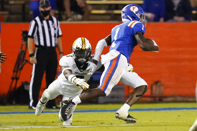 Florida wide receiver Kadarius Toney (1) breaks away from Missouri safety Tyree Gillespie, left, on his way to a touchdown during the first half of an NCAA college football game Saturday, Oct. 31, 2020, in Gainesville, Fla. (AP Photo/John Raoux)