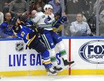 St. Louis Blues' Alex Pietrangelo (27) collides with Vancouver Canucks' Michael Ferland (79) during the second period of an NHL hockey game, Thursday, Oct. 17, 2019, in St. Louis. (AP Photo/Bill Boyce)