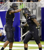 Vanderbilt wide receiver Amir Abdur-Rahman (87) taps running back Ke'Shawn Vaughn (5) on the helmet in celebration after Vaughn's touchdown run against Baylor during the first half of the Texas Bowl NCAA college football game Thursday, Dec. 27, 2018, in Houston. (AP Photo/Michael Wyke)