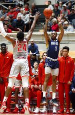 Kent State guard CJ Williamson, right, shoots in front of Ohio State forward Andre Wesson during the first half of an NCAA college basketball game in Columbus, Ohio, Monday, Nov. 25, 2019. (AP Photo/Paul Vernon)