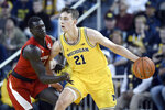 Michigan guard Franz Wagner, right, tries to get around Nebraska forward Akol Arop during the first half of an NCAA college basketball game Thursday, March 5, 2020, in Ann Arbor, Mich. (AP Photo/Jose Juarez)