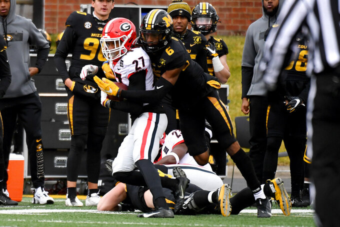 Georgia defensive back Eric Stokes (27) intercepts a pass intended for Missouri wide receiver Keke Chism (6) during the first half of an NCAA college football game Saturday, Dec. 12, 2020, in Columbia, Mo. (AP Photo/L.G. Patterson)
