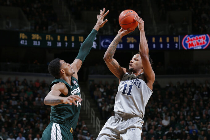 Penn State's Lamar Stevens, right, shoots against Michigan State's Xavier Tillman during the first half of an NCAA college basketball game Tuesday, Feb. 4, 2020, in East Lansing, Mich. (AP Photo/Al Goldis)