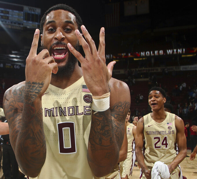 Florida State forward Phil Cofer holds up six fingers - the team's number of wins in a row - after an NCAA college basketball game against Wake Forest in Tallahassee, Fla., Wednesday, Feb. 13, 2019. Florida State won 88-66. (AP Photo/Phil Sears)