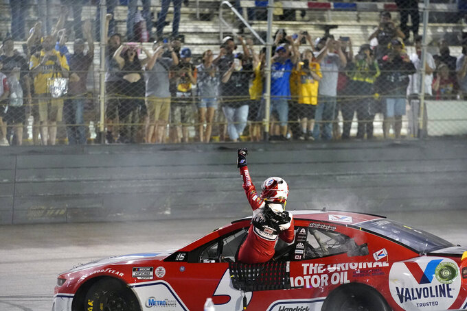 Kyle Larson waves to fans after winning a NASCAR Cup Series auto race at Bristol Motor Speedway Saturday, Sept. 18, 2021, in Bristol, Tenn. (AP Photo/Mark Humphrey)