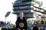 FILE - In this May 1, 2003, file photo, President George W. Bush declares the end of major combat in Iraq as he speaks aboard the aircraft carrier USS Abraham Lincoln off the California coast. (AP Photo/J. Scott Applewhite, File)
