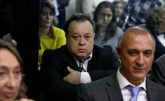FILE - In this Aug. 6, 2015 file photo, Carlos Telleldin attends a trial where he and others are accused of derailing an investigation into the 1994 bombing of the Argentina Jewish Center in Buenos Aires, Argentina. A court on Wednesday, Dec. 23, 2020, has cleared Telleldin, the only Argentine still facing charges in the bombing.  (AP Photo/Natacha Pisarenko, File)