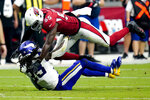 Arizona Cardinals linebacker Chandler Jones (55) hits Minnesota Vikings running back Dalvin Cook (33) during the second half of an NFL football game, Sunday, Sept. 19, 2021, in Glendale, Ariz. (AP Photo/Ross D. Franklin)