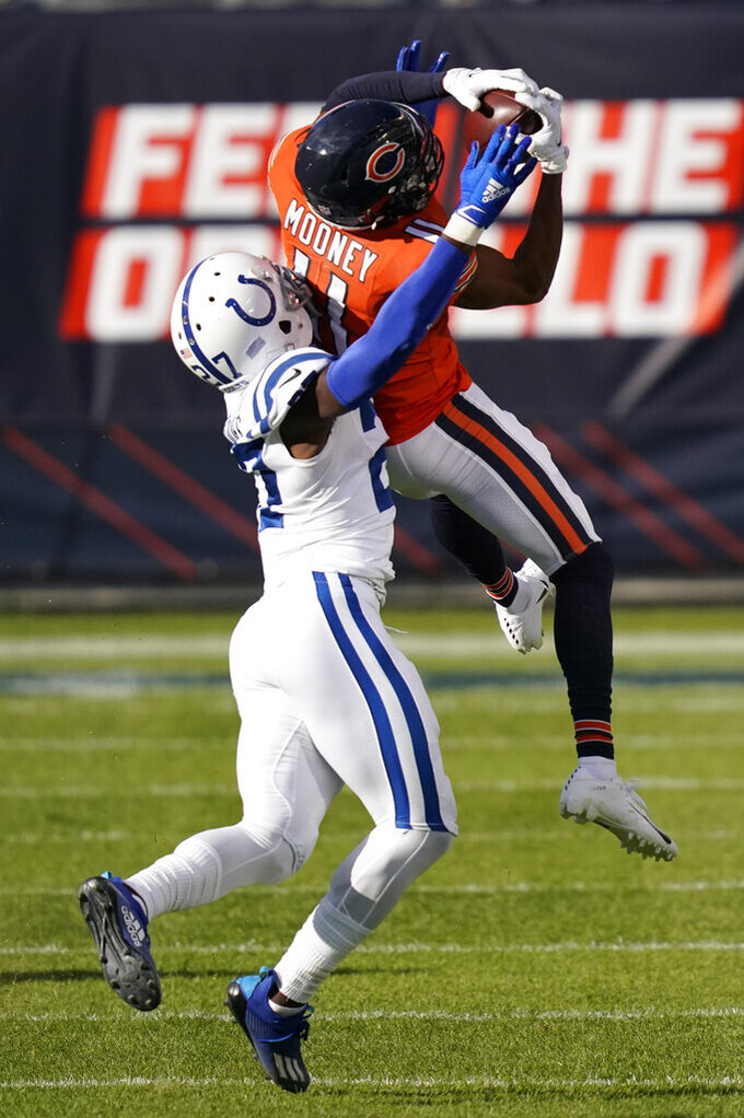 Chicago Bears' Darnell Mooney (11) makes a catch against Indianapolis Colts' Xavier Rhodes (27) during the first half of an NFL football game, Sunday, Oct. 4, 2020, in Chicago. (AP Photo/Charles Rex Arbogast)