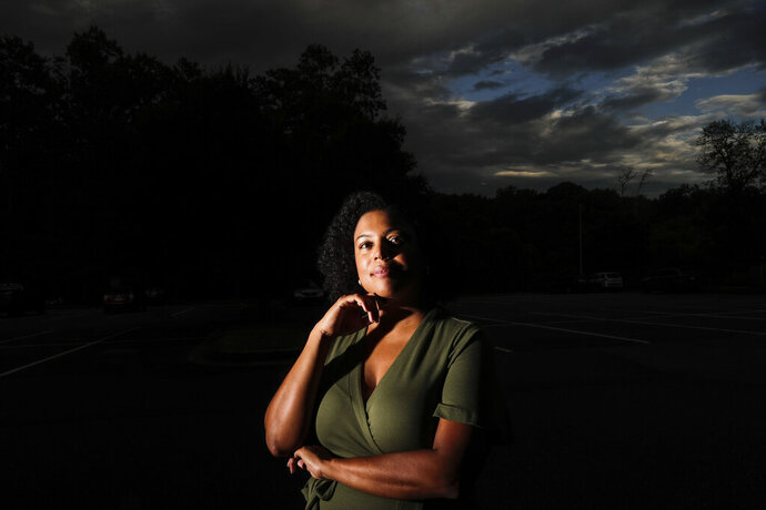 Charisse Davis poses for a portrait on Friday, July 24, 2020, in Marietta, Ga. Davis was recently elected the only Black woman on the Cobb County School Board.