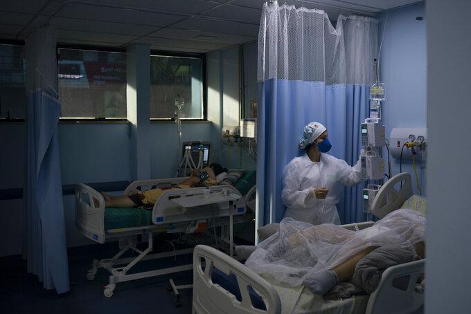COVID-19 patients are treated in the municipal hospital of Sao Joao de Meriti, Rio de Janeiro state, Brazil, Thursday, April 8, 2021. (AP Photo/Felipe Dana)