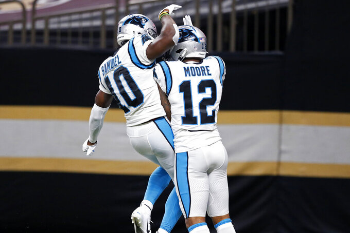 Carolina Panthers wide receiver D.J. Moore (12) celebrate his touchdown reception with wide receiver Curtis Samuel (10) in the first half of an NFL football game against the New Orleans Saints in New Orleans, Sunday, Oct. 25, 2020. (AP Photo/Butch Dill)