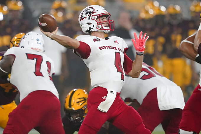 Southern Utah quarterback Justin Miller (4) throws against Arizona State during the first half of an NCAA college football game, Thursday, Sept. 2, 2021, in Tempe, Ariz. (AP Photo/Matt York)