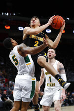 Northern Kentucky guard Paul Djoko (2) drives on Wright State guard Skyelar Potter (5) during the second half of an NCAA college basketball game for the Horizon League men's tournament championship in Detroit, Tuesday, March 12, 2019. (AP Photo/Paul Sancya)