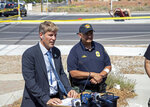 Albuquerque Mayor Tim Keller, left, and Police Chief Harold Medina hold a news conference in Albuquerque, N.M., Saturday, June 26, 2021. Police said five occupants of a hot air balloon died after they crashed on a busy street. (AP Photo/Andres Leighton)