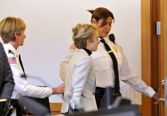 Michelle Carter, 22, center,  is led away by court officers after a hearing on her prison sentence in Taunton District Court in Taunton, Mass. Monday, February 11, 2019. Carter was jailed Monday on an involuntary manslaughter conviction. She was convicted in 2017 of involuntary manslaughter and sentenced to a 15 month prison term for encouraging 18-year-old Conrad Roy, III to kill himself when she instructed him over the phone to get back in his truck that was filling with toxic gas in July 2014.  (Mark Stockwell/The Sun Chronicle via AP, Pool)