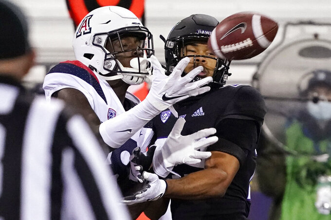 Arizona's Ma'jon Wright catches an 11-yard touchdown pass as Washington's Julius Irvin, right, defends during the second half of an NCAA college football game Saturday, Nov. 21, 2020, in Seattle. (AP Photo/Elaine Thompson)