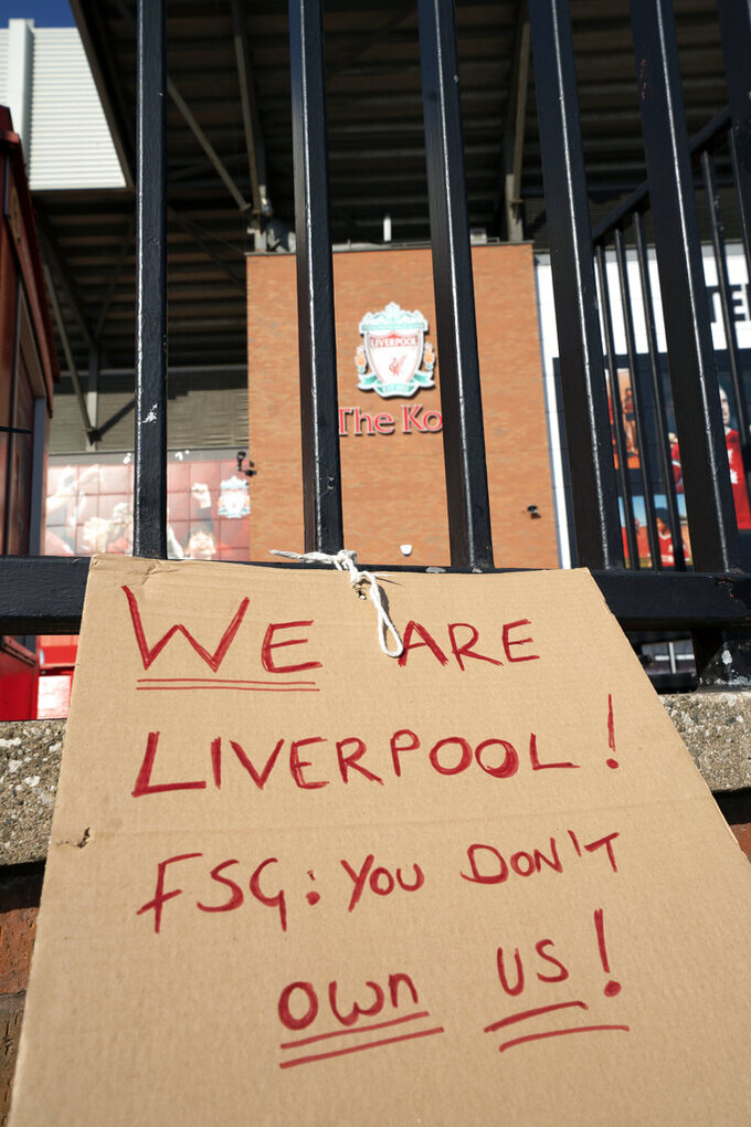 A sign is seen outside Liverpool's Anfield Stadium protesting the formation of the European Super League, Liverpool, England, Monday, April 19, 2021. Players at the 12 clubs setting up their own Super League could be banned from this year's European Championship and next year's World Cup, UEFA President Aleksander Ceferin said Monday.