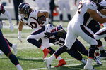 New England Patriots linebacker Ja'Whaun Bentley (51) tackles Denver Broncos running back Phillip Lindsay (30) in the first half of an NFL football game, Sunday, Oct. 18, 2020, in Foxborough, Mass. (AP Photo/Charles Krupa)