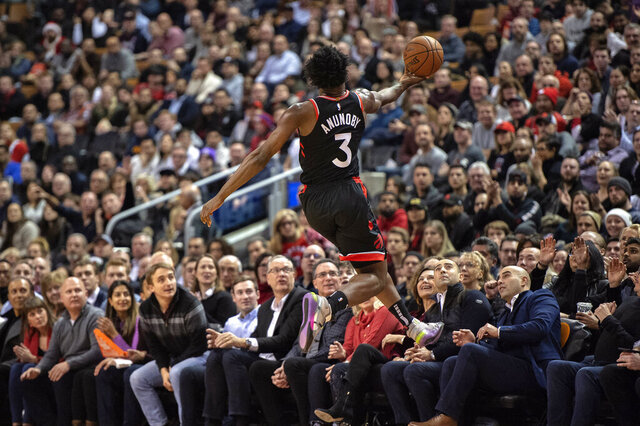Toronto Raptors forward OG Anunoby (3) recovers the ball about to go out of bounds during the first half of the team's NBA basketball game against the Washington Wizards on Friday, Dec. 20, 2019, in Toronto. (Frank Gunn/The Canadian Press via AP)