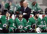 Dallas Stars' Roope Hintz, Mats Zuccarello and Alexander Radulov sit on the bench as coach Jim Montgomery, center rear, watches play against the Nashville Predators during the third period of Game 4 in an NHL hockey first-round playoff series in Dallas, Wednesday, April 17, 2019. (AP Photo/Tony Gutierrez)
