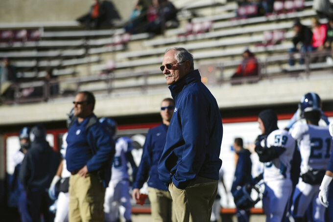 FILE - In this Nov. 29, 2014, file photo, San Diego head coach Dale Lindsey watches from the sideline before the start of an NCAA college football playoff game against Montana, in Missoula, Mont. The University of San Diego is in the FCS playoffs for the third straight year under 75-year-old coach Dale Lindsey and senior quarterback Anthony Lawrence. It's a terrific accomplishment, considering that the Toreros don't offer football schoarlships and it costs $65,426 a year to attend the small Catholic school known for its Spanish Renaissance architecture and a million-dollar view of Mission Bay and the Pacific Ocean.  (AP Photo/Lido Vizzutti, File)