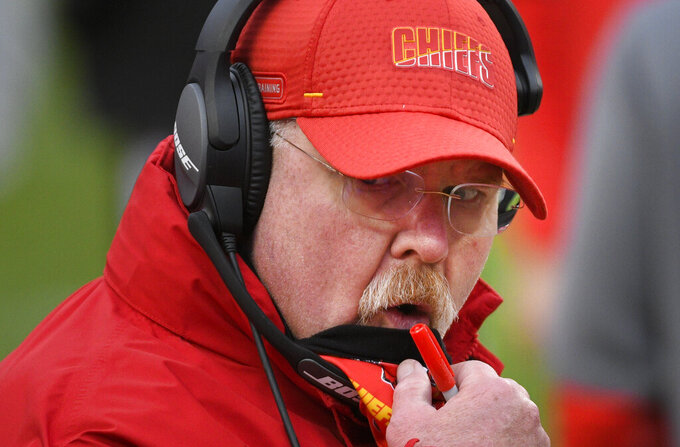 FILE - In this Jan. 17, 2021, file photo, Kansas City Chiefs head coach Andy Reid watches from the sideline during an NFL divisional round playoff football game against the Cleveland Browns in Kansas City, Mo. Putting together the NFL schedule might be as complex as space travel. All 32 teams have preferences, there are stadium and city issues to deal with, bye weeks to consider and, most importantly, attempting to avoid competitive imbalances. The two Week 1 highlight matchups have Cleveland at Kansas City and Pittsburgh at Buffalo, all potential powers in the AFC.  (AP Photo/Reed Hoffmann, File)