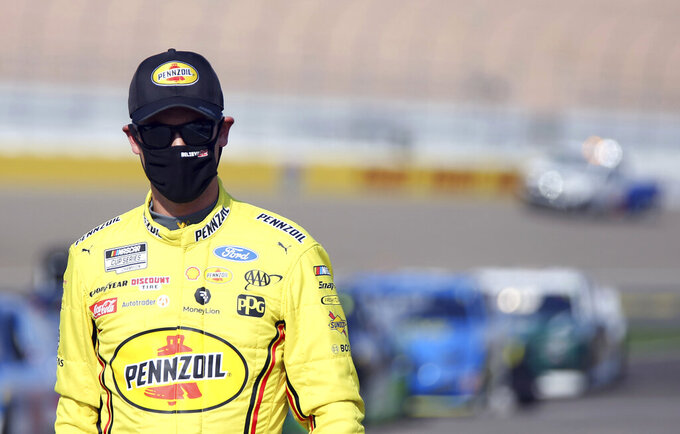 Joey Logano walks to his race car before a NASCAR Cup Series auto race Sunday, Sept. 27, 2020, in Las Vegas. (AP Photo/Isaac Brekken)