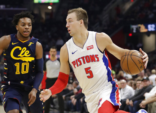 FILE - In this Dec. 3, 2019, file photo, Detroit Pistons' Luke Kennard (5) drives against Cleveland Cavaliers' Darius Garland (10) during the second half of an NBA basketball game in Cleveland. The Los Angeles Clippers acquired  Kennard from Detroit as part of a three-way deal with the Pistons and Brooklyn on Wednesday, Nov. 18, 2020. (AP Photo/Tony Dejak, File)