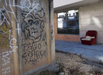 In this Sunday, March 17, 2019 photo, graffiti depicting Bosnian Serb wartime leader Radovan Karadzic on a wall in the Bosnian Serb wartime stronghold of Pale, Bosnia-Herzegovina. Nearly a quarter of a century since Bosnia's devastating war ended, former Bosnian Serb leader Radovan Karadzic is set to hear the final judgment on whether he can be held criminally responsible for unleashing a wave of murder and mistreatment by his administration's forces. United Nations appeals judges on Wednesday March 20, 2019 will decide whether to uphold or overturn Karadzic's 2016 convictions for genocide, crimes against humanity and war crimes and his 40-year sentence. The text in Cyrillic reads: