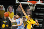 North Carolina guard Andrew Platek passes in front of Iowa forward Jack Nunge, right, during the second half of an NCAA college basketball game, Tuesday, Dec. 8, 2020, in Iowa City, Iowa. Iowa won 93-80. (AP Photo/Charlie Neibergall)