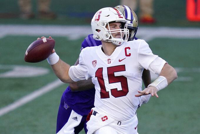 Stanford quarterback Davis Mills throws against Washington in the first half of an NCAA college football game Saturday, Dec. 5, 2020, in Seattle. (AP Photo/Elaine Thompson)
