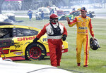 Joey Logano (22) waves to fans after crashing during a NASCAR Series auto race at Indianapolis Motor Speedway, Sunday, Aug. 15, 2021, in Indianapolis. (Randy Crist/The Indianapolis Star via AP)