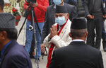 Nepalese Prime minister Khadga Prassad Oli arrives for the Parliament session in Kathmandu, Nepal, Sunday, March 7, 2021. Nepal's Parliament reinstated by the nation's Supreme Court began session on Sunday that would likely determine the future of the prime minister and government. (AP Photo/Niranjan Shrestha)