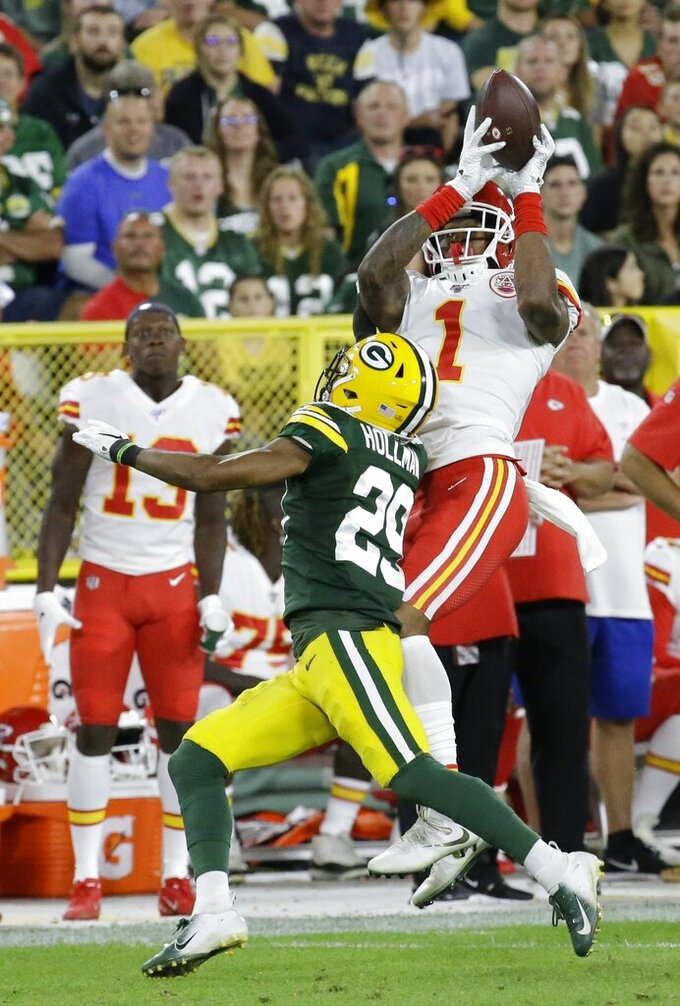 Kansas City Chiefs' Jody Fortson catches a pass over Green Bay Packers' Ka'Dar Hollman during the first half of a preseason NFL football game Thursday, Aug. 29, 2019, in Green Bay, Wis. (AP Photo/Mike Roemer)
