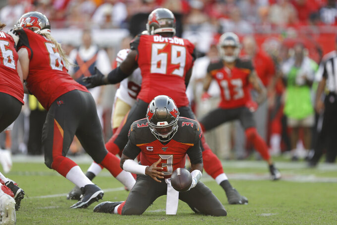 Tampa Bay Buccaneers quarterback Jameis Winston (3) tries to keep a loose ball against the San Francisco 49ers during the second half an NFL football game, Sunday, Sept. 8, 2019, in Tampa, Fla. (AP Photo/Chris O'Meara)