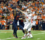 Syracuse linebacker Kielan Whitner, left, tips a pass by NC State quarterback Ryan Finley during the first half of an NCAA college football game in Syracuse, N.Y., Saturday, Oct. 27, 2018. (AP Photo/Adrian Kraus)