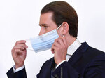 Austrian Chancellor Sebastian Kurz adjust a face mask during a news conference about the coronavirus situation in Austria, in Vienna, Austria, Monday, April 6, 2020.  The COVID-19 coronavirus causes less serious symptoms for most people, but for some it causes severe illness and even death.(Helmut Foringer/Pool via AP)