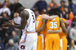 Auburn forward Danjel Purifoy (3) takes the court as Tennessee huddles before the first half of an NCAA college basketball game Saturday, Feb. 22, 2020, in Auburn, Ala. (AP Photo/Julie Bennett)