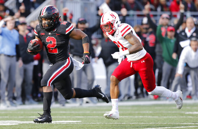 Ohio State running back J.K. Dobbins, left, breaks away from Nebraska defensive back Lamar Jackson to score a touchdown during the second half of an NCAA college football game Saturday, Nov. 3, 2018, in Columbus, Ohio. Ohio State beat Nebraska 36-31. (AP Photo/Jay LaPrete)