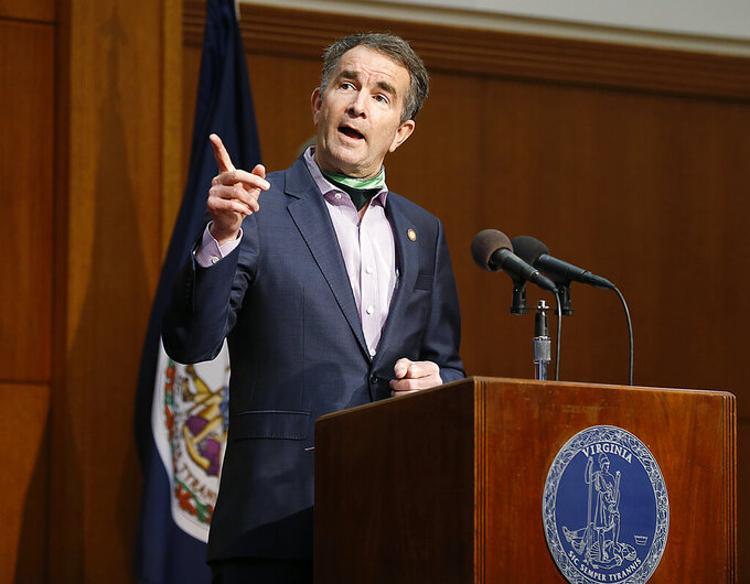 Virginia Gov. Ralph Northam speaks during the COVID-19 update news conference in the Patrick Henry Building Friday May 8, 2020 in Richmond, Va. (Mark Gormus/Richmond Times-Dispatch via AP)