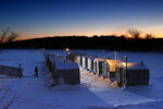 FILE - In this Feb. 2, 2018 file photo, fishermen arrive for an evening of smelt fishing at Jim's Camp's on the Cathance River in Bowdoinham, Maine. Maine's smelts, a small fish beloved by ice fisherman, appear to be continuing a rebound in population after years of decline. (AP Photo/Robert F. Bukaty, File)